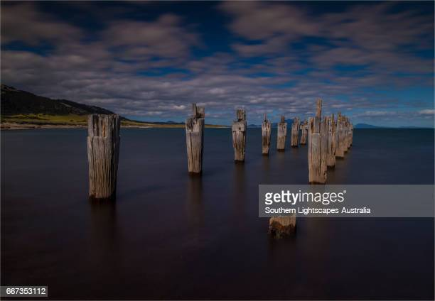 Old derelict pier at Lillies beach, on the coastline of Sawyer's bay, Flinders Island, Bass Strait, Tasmania, Australia.