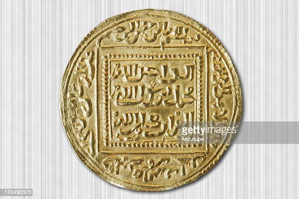 Old dinar coin from the 14th century