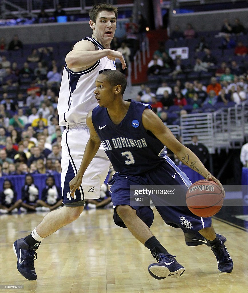 Old Dominion Monarchs guard Darius James drives around Butler Bulldogs center Andrew Smith during firsthalf action in the second round of the 2011...