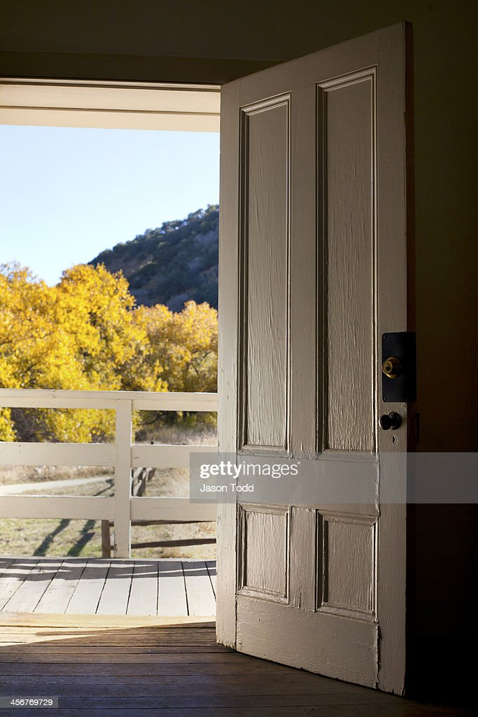Old door looking out to fall foliage