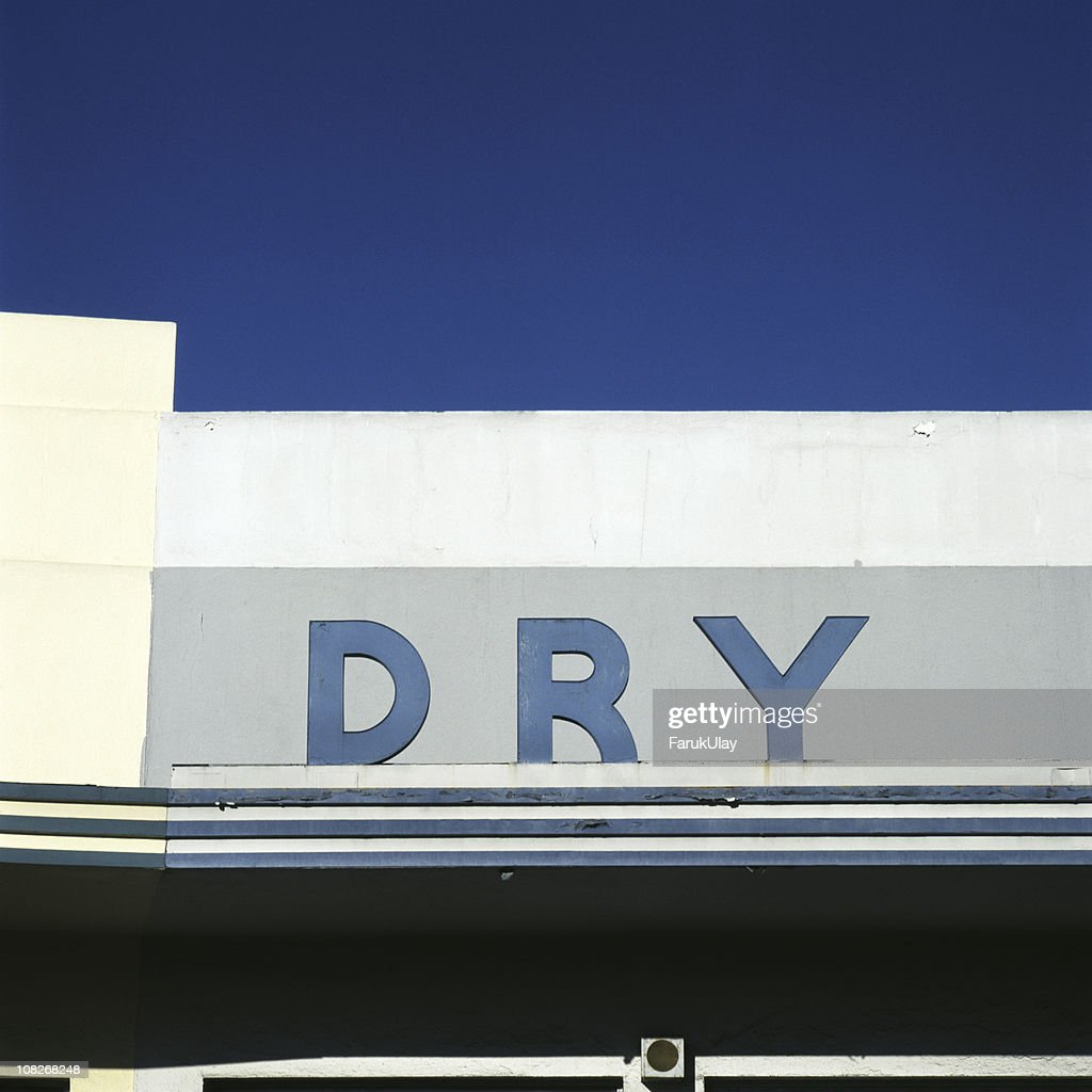 Old 'Dry' Sign on Building : Stock Photo