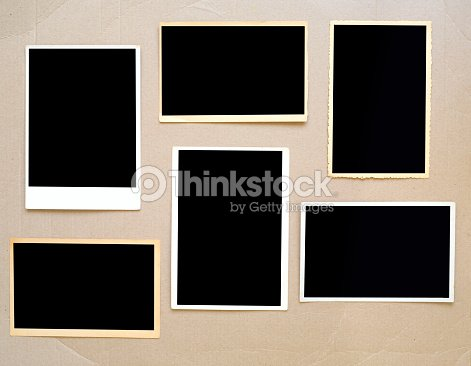 old empty photo frames, vintage photo prints on cardboard with free pics space : Stock Photo