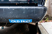 OLD FART bumper sticker on even older fart of a car. Horizontal.