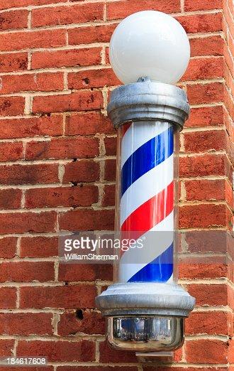 Old Fashioned Barbershop Pole On Brick Wall