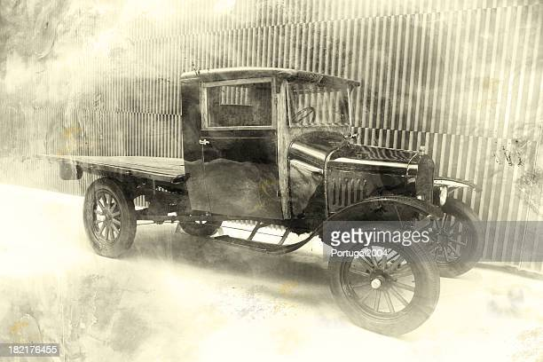 Old fashioned black and white photo of old car