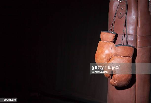 Old Fashioned Boxing Gloves And Punching Bag