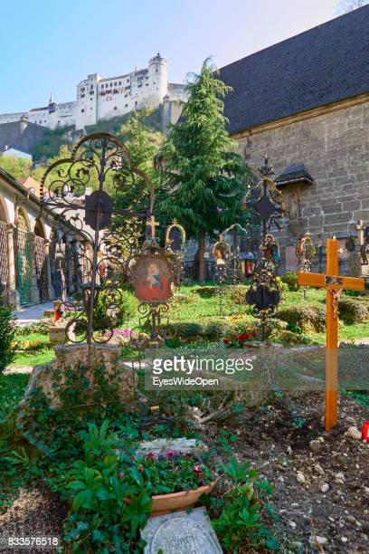 Old fashioned cemetery next to the fortress Hohensalzburg castle in the historic center on April 19 2015 in Salzburg Austria