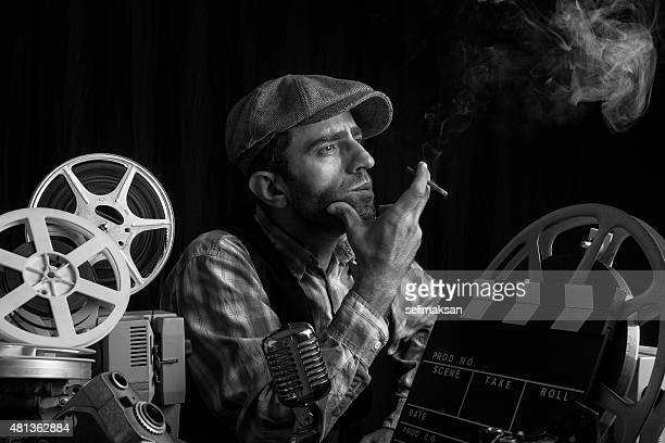 Old Fashioned Film Director Posing With Cinema Equipments And Smoking