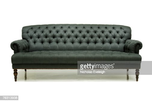 Old Fashioned Grey Couch On White Background Stock Photo | Getty Images