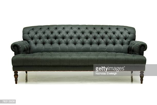 Old fashioned grey couch on white background