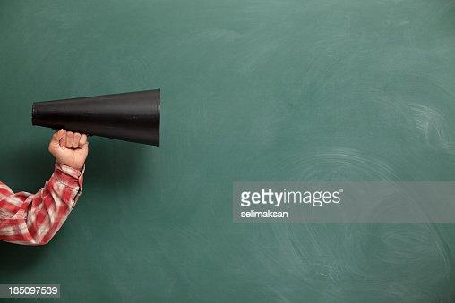 Old Fashioned Megaphone In Human Hand On Green Blank Blackboard