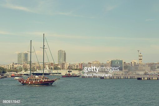 Old fashioned sailboat in the bay of Barcelona, Spain