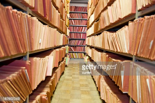 Old files stacked on library shelves