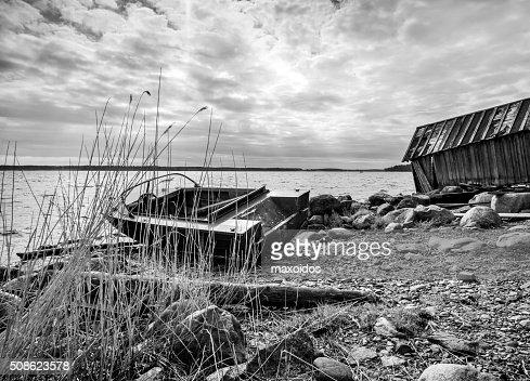 Old fishing motor boat on lake coast : Stock Photo