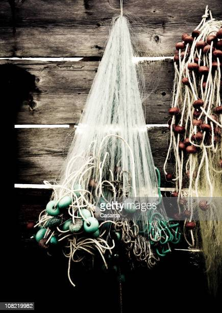 Old Fishing Nets Hung on Rack of Wooden Building