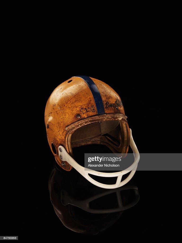 old football helmet on black background : Stock Photo