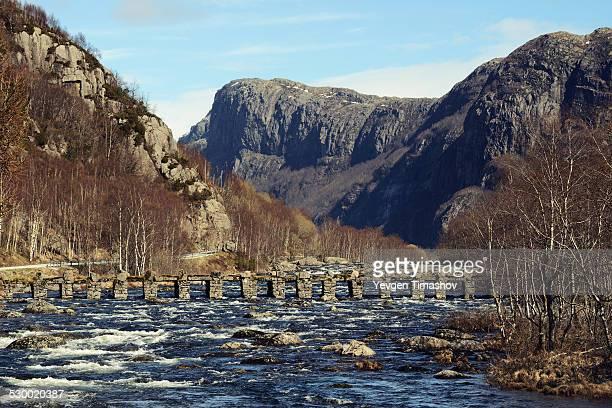 Old footbridge crossing river, Rogaland County, Norway