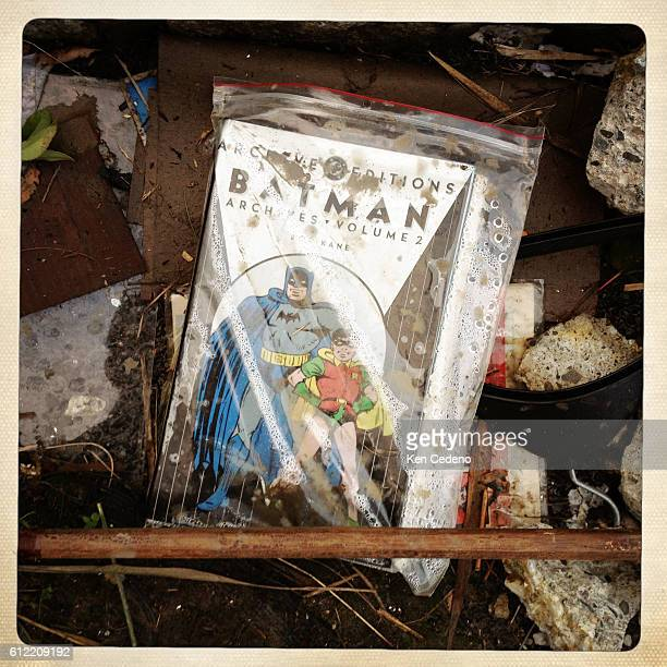 Old framed and sealed comic books are found among the personal belongings whre these homes once were after being severely damaged by Superstorm Sandy...