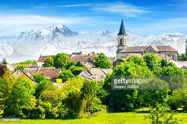 Old French village in countryside with Mont Blanc Alps mountains