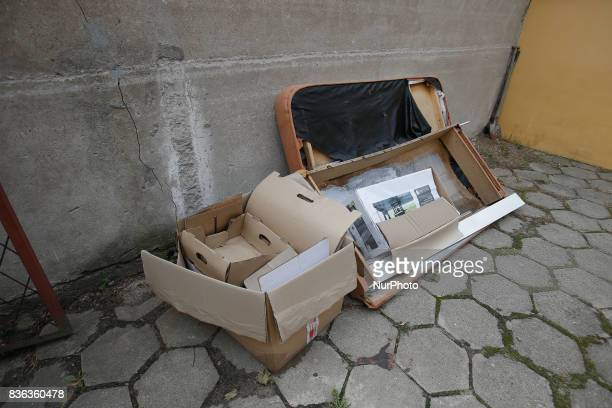 Old furniture is seen in a trash disposal area near a residential building on 19 August 2017
