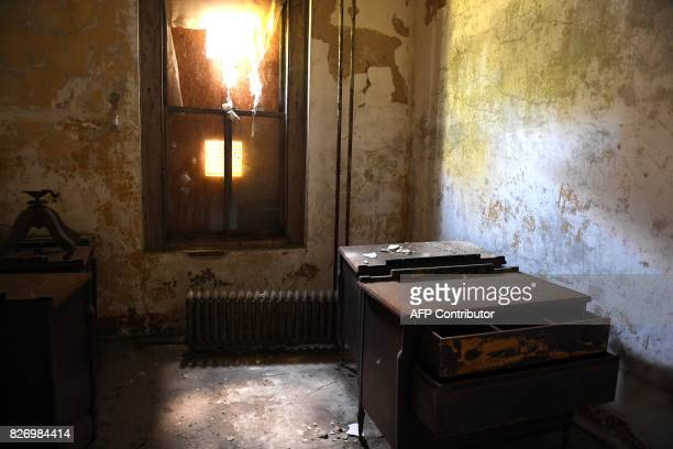 old furniture remains inside a room in one of the buildings of the The Ellis Island Hospital August 5 a 750bed facility which treated over 12 million...
