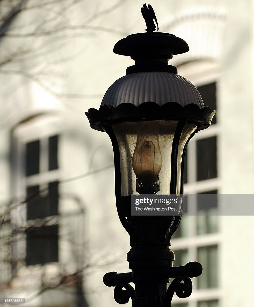 Old gas lamps decorate the front yards of the old town houses in the Foggy Bottom neighborhood in Northwest.