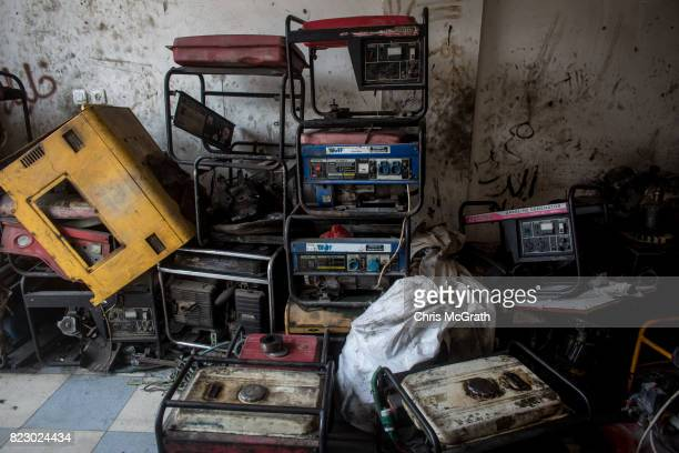 Old generators are seen stacked up at a generator repair shop on July 20 2017 in Gaza City Gaza For the past ten years Gaza residents have lived with...