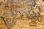 Old Geographic map of the world printed on a wooden board