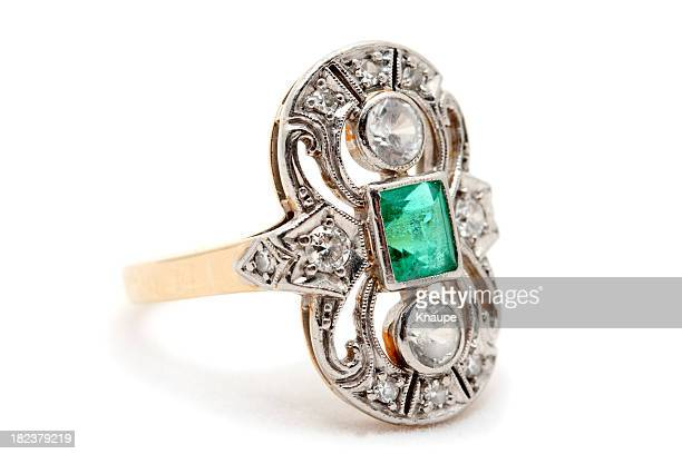 Old Gold Ring with Emerald and Diamonds on White Background
