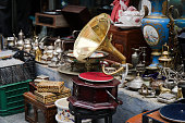 An old gramophone and other antique objects at antiques market in street