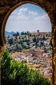 Old town of Granada seen from an arched window in the Alhambra