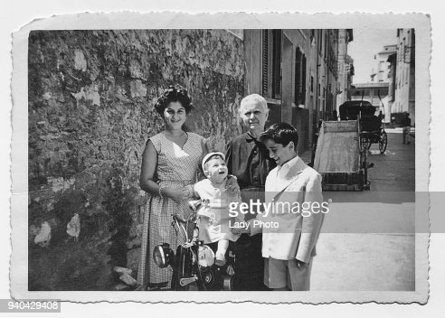 Old grandmother with grandchildren in 1952, Tuscany, Italy : Stock Photo