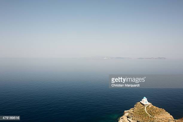 A old Greec orthodox church on top of a small hill next to Aegean Sea on June 17 2015 in Sifnos Greece Sifnos is a island in the western Aegean Sea...