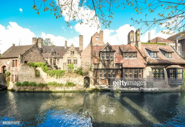 Old Groeninge canal view and waterfront with medieval civil architecture samples in Bruges, Flander