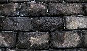 Old grunge natural bricks (blocks) textured stone background