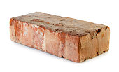 Old grungy brick isolated over white background