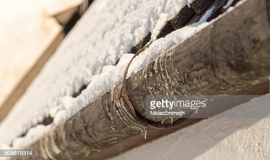Old Gutter with Snow : Stock Photo