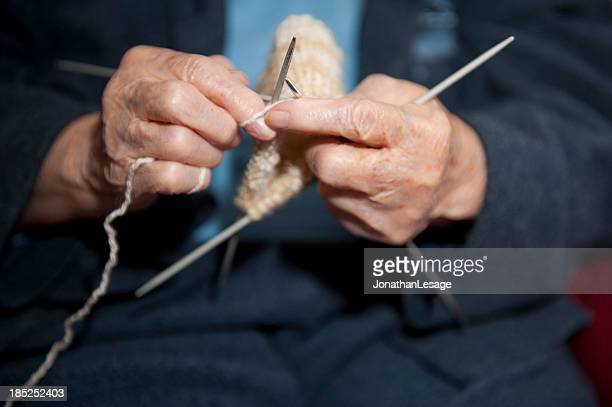 old  hands knitting with needles, my grand mother