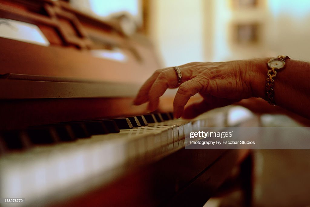 Old hands playing piano : Stock Photo