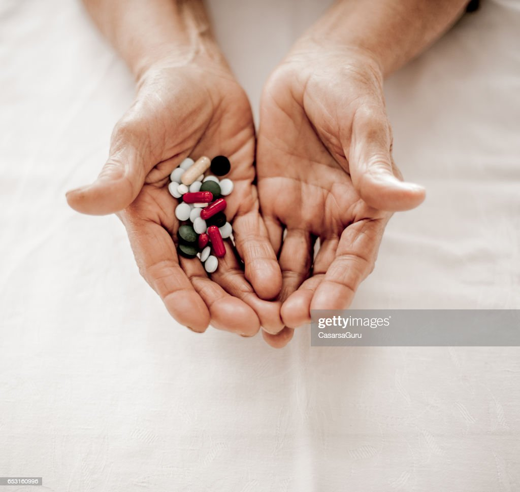 Old Hands Taking Medicine - Close Up : Stockfoto