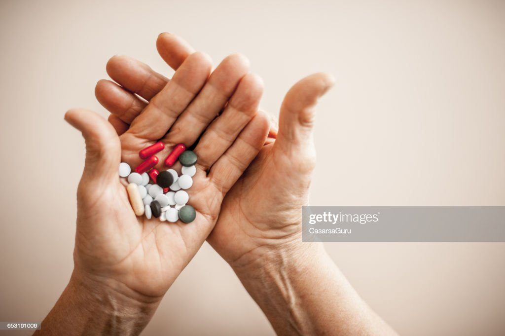 Old Hands Taking Medicine - Close Up : Foto stock
