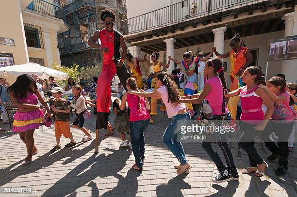 Old Havana street dancers on stilts