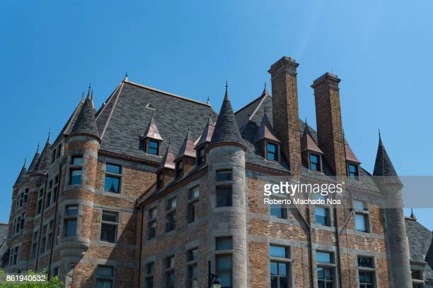 Old heritage castlestyle building it has brick and stone walls tiled sloping roof turrets and windows Old Montreal is a Unesco World Heritage Site