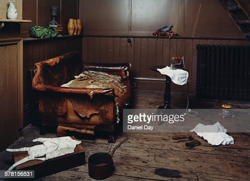 Old House With Worn Out Couch Stock Photo | Getty Images