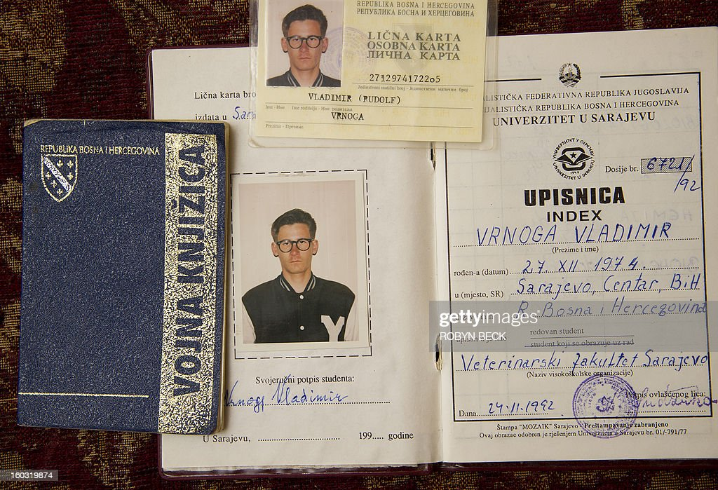 Old identification documents belonging to Vladimir Vrnoga are seen at Vrnoga's home in Chico, California on December 16, 2012. Twenty years have passed since Vrnoga served three hard years in the Bosnian and fled to the United States. He now lives with his mother, his wife and three year old daughter in Chico, north of San Francisco, where he is employed by a large beverage manufacturer.