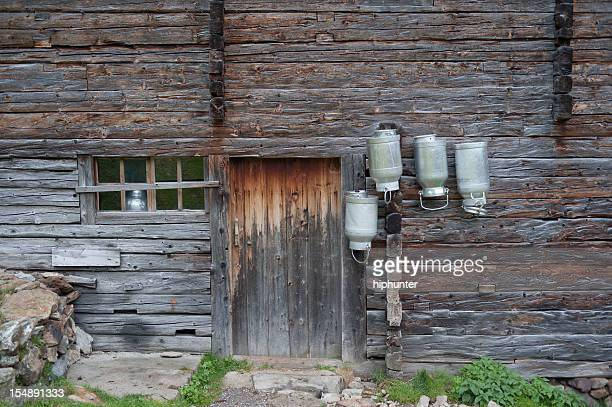 Old Idyllic Cowhouse with Milk Canister