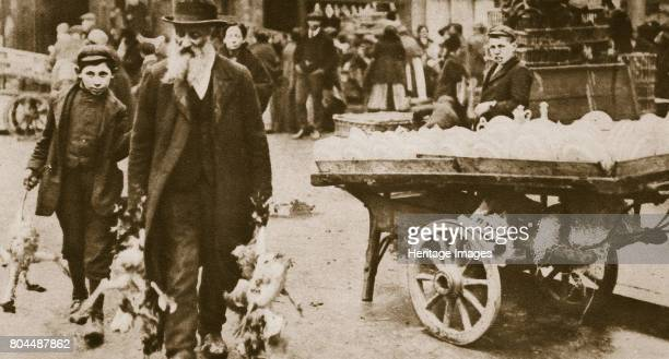 Old Jewish man and his grandson carrying some fowls Wentworth Street Stepney London 20th century Stepney was the centre of London's Jewish community...