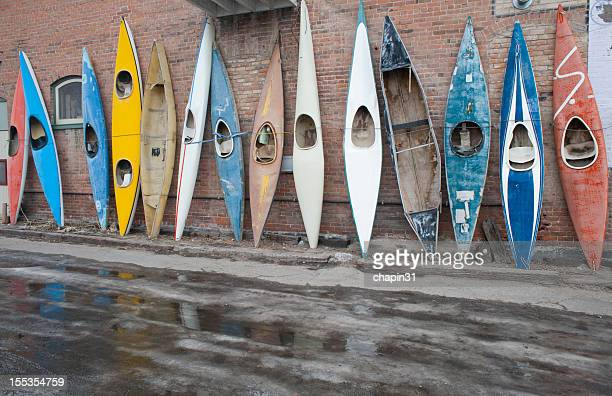 Old Kayaks on a Brick Wall