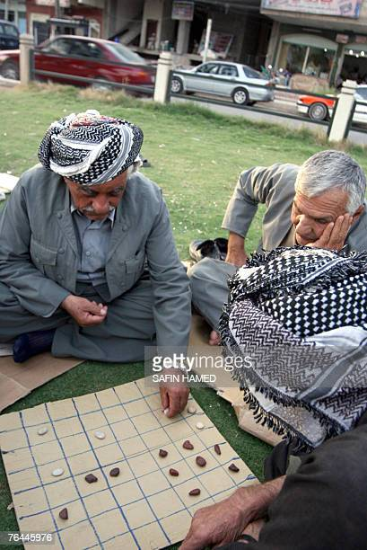 Old Kurdish Iraqi men play Dama a traditional local game in Arbil 350 kms northern Baghdad 30 August 2007 Iraq has complained since June 2007 that...