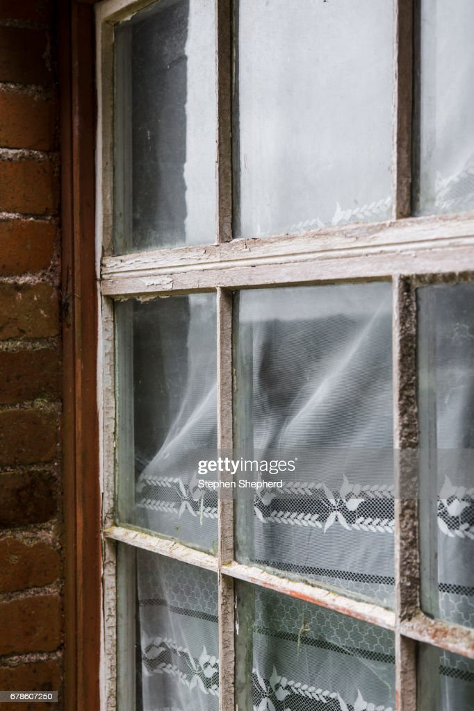 Old Lace Curtains, Rotten Window Frames In An Abandoned House. : Stock Photo